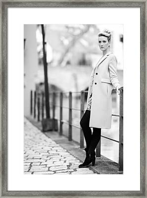 Woman With A Coat Framed Print by Ralf Kaiser