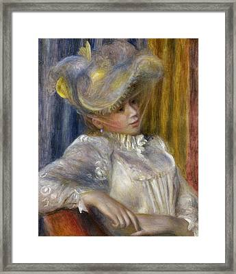 Woman With A Hat Framed Print by Auguste Renoir