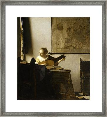 Woman With A Lute Near A Window Framed Print