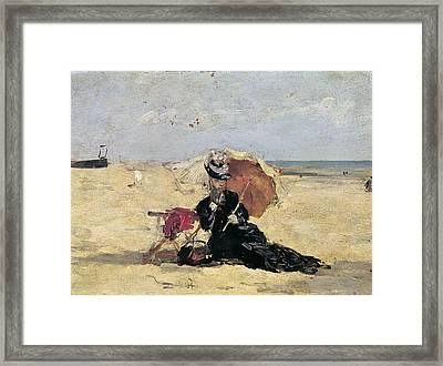Woman With A Parasol On The Beach Framed Print