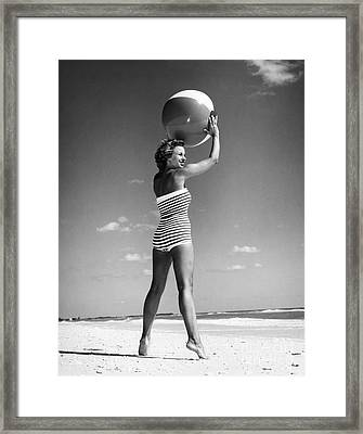 Woman With Beach Ball, C.1960s Framed Print by H. Armstrong Roberts/ClassicStock