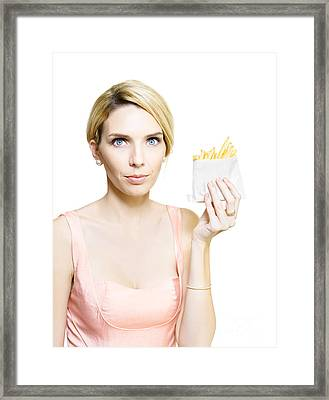 Woman With Greasy Packet Of French Fries Framed Print by Jorgo Photography - Wall Art Gallery