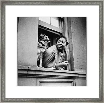 Woman With Her Dog In Harlem, New York Framed Print by Everett