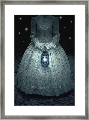 Woman With Lantern Framed Print