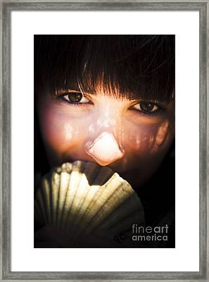 Woman With Seashell Framed Print