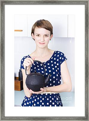 Woman With Tea Kettle Framed Print by Jorgo Photography - Wall Art Gallery