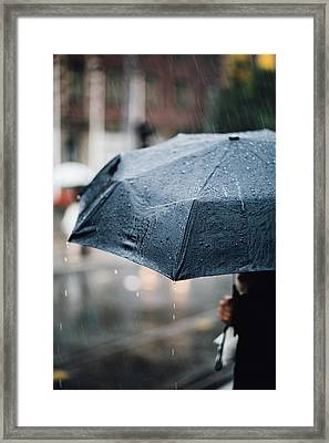Woman With Umbrella In The Rain Framed Print