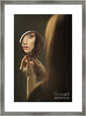Woman's Face In The Mirror Framed Print