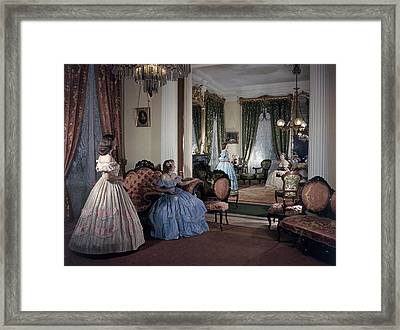 Women In Period Costumes Sit In An Framed Print by Willard Culver