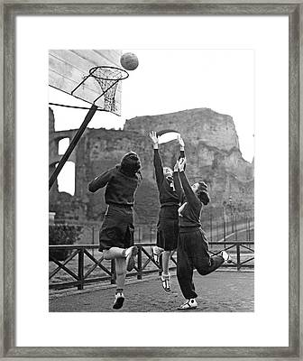 Women Playing Basketball Framed Print by Underwood Archives