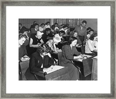 Women Taking Police Exam Framed Print