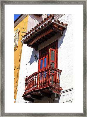 Wood Balcony In Cartagena Framed Print by John Rizzuto