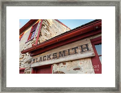 Wood Blacksmith Sign On Building Framed Print