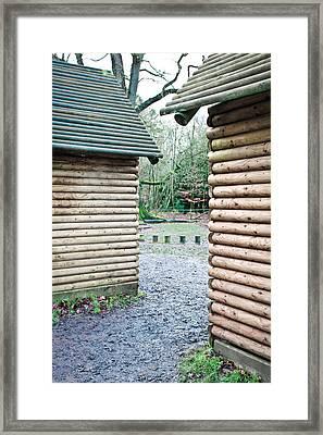 Wood Cabins Framed Print by Tom Gowanlock
