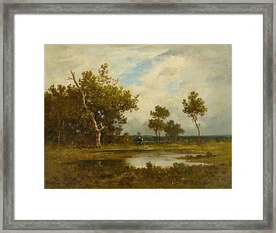 Wood Gatherer At A Pond Framed Print
