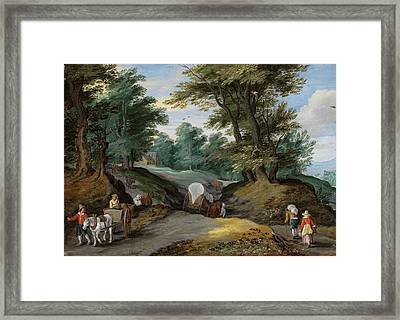 Wooded Landscape With Horses Carts And To The Market Attracting Farmers Framed Print by Jan Brueghel the Younger