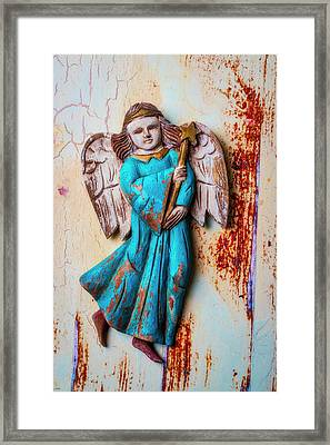 Wooden Angel On Old Wall Framed Print