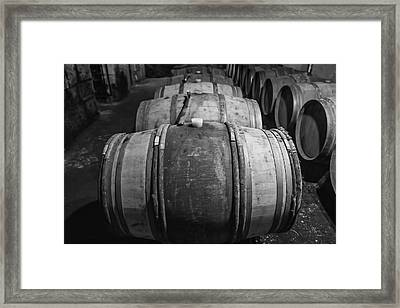 Wooden Barrels In A Wine Cellar Framed Print