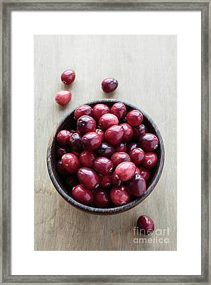 Wooden Bowl Of Ripe Red Cranberries Framed Print by Edward Fielding
