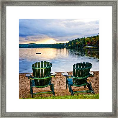 Wooden Chairs At Sunset On Beach Framed Print by Elena Elisseeva