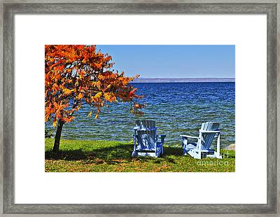 Wooden Chairs On Autumn Lake Framed Print by Elena Elisseeva