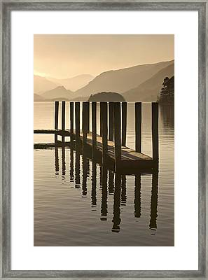 Wooden Dock In The Lake At Sunset Framed Print by John Short