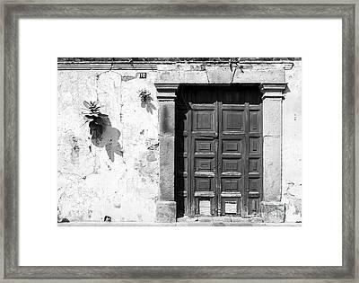 Framed Print featuring the photograph Wooden Door Antigua Guatemala Black And White by Tim Hester