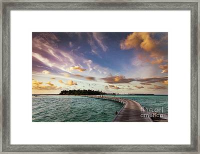 Wooden Jetty Towards A Small Island In Maldives At Sunset Framed Print