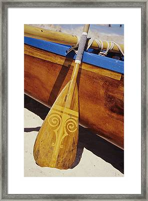 Wooden Paddle And Canoe Framed Print