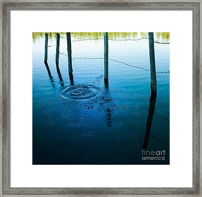 Wooden Post In A Lake Framed Print by Bernard Jaubert