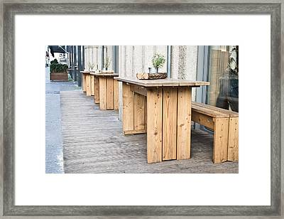 Wooden Tables Framed Print by Tom Gowanlock