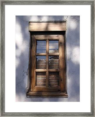 Wooden Window In The Shadows Framed Print by Kim Chernecky