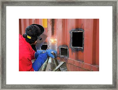 Worker Repair Container Box By Gas Cutting And Welding Framed Print by Anek Suwannaphoom