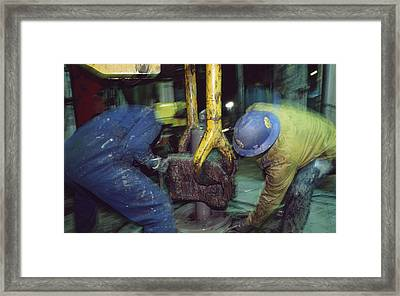 Workers On An Oil Rig Platform Framed Print by Justin Guariglia