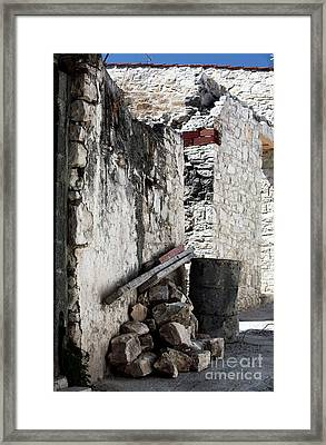 Working In Cyprus Framed Print by John Rizzuto