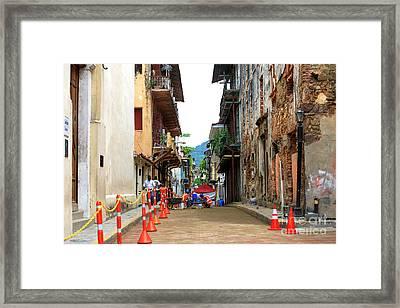 Working On The Street Framed Print by John Rizzuto