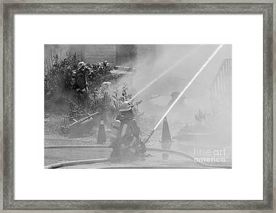Working The Fire Framed Print