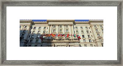 World Flags Blow In The Breeze In Front Framed Print by Panoramic Images