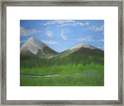 World Of Twin Moons Framed Print by Law Stinson