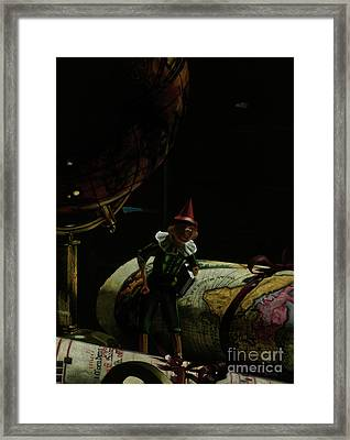 World Traveler Pinocchio Framed Print by Kelly Borsheim