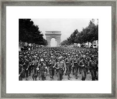 World War II American Troops Marching Framed Print by Everett