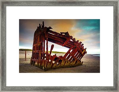 Worn Rusting Shipwreck Framed Print by Garry Gay
