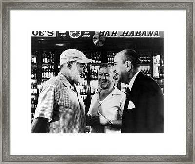 Writer Ernest Hemingway Chats Framed Print by Everett