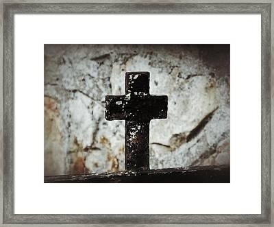 Wrought Iron Cross Against Stone Framed Print