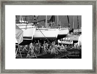 Yachts On Drydock Framed Print by Gaspar Avila