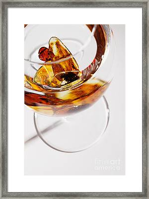 Framed Print featuring the photograph Yellow Amber Stones In A Glass. by Andrey  Godyaykin