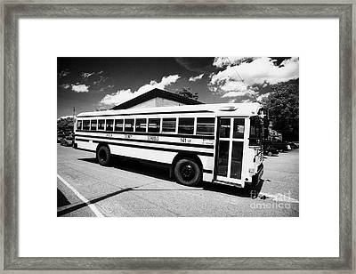 yellow american bluebird school bus in Lynchburg tennessee usa Framed Print