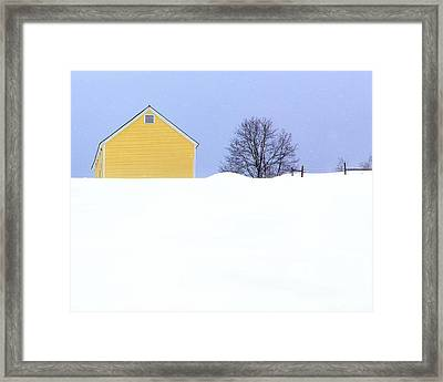 Yellow Barn In Snow Framed Print by John Vose