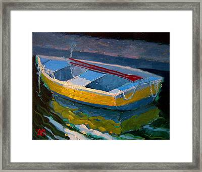 Yellow Boat And Red Oars Framed Print by Robert Lewis