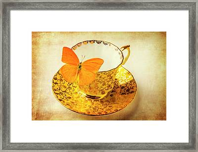 Yellow Butterfly On Yellow Tea Cup Framed Print